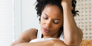 o-sad-black-woman-on-bed-facebook (1)